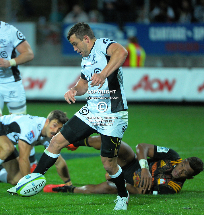 Keegan Daniel hacks at loose ball during the Super Rugby match between the Chiefs and Lions at Yarrow Stadium, New Plymouth, New Zealand on Saturday, 5 March 2016. Photo: Dave Lintott / lintottphoto.co.nz