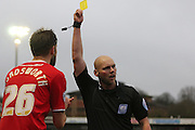 Referee Charles Breakspear  shows the yellow card to Crawley's Anthony Wordsworth during the Sky Bet League 1 match between Crawley Town and Sheffield Utd at the Checkatrade.com Stadium, Crawley, England on 28 February 2015. Photo by Phil Duncan.