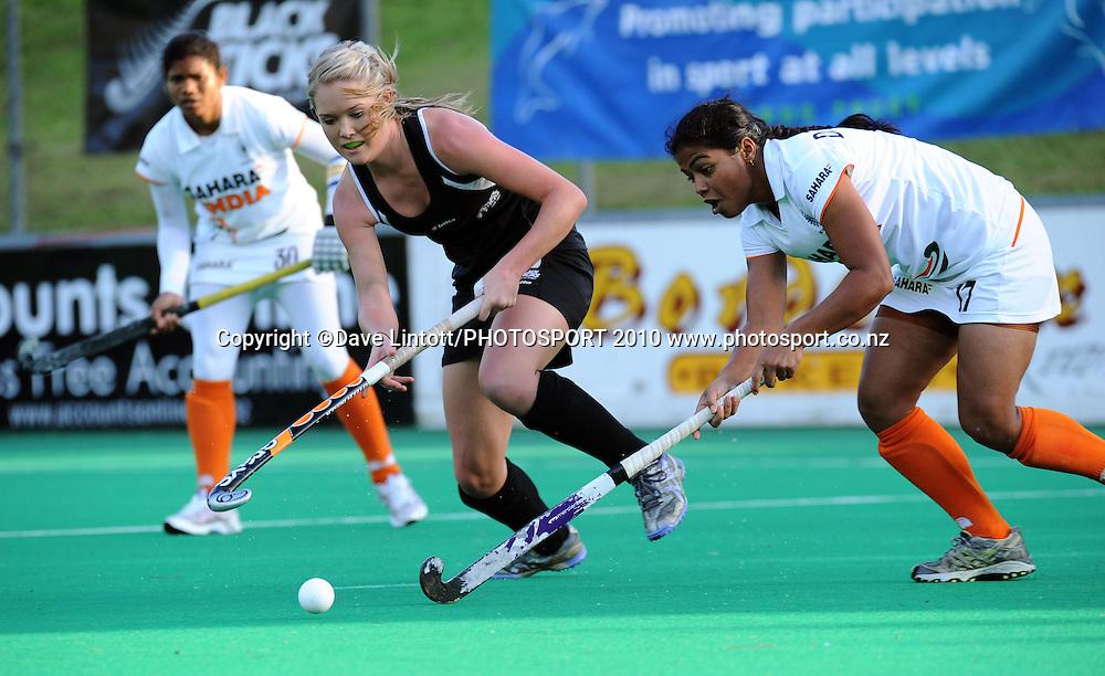 NZ's Sam Harrison and India's Deepika Thakur chase the ball.<br /> International hockey match - New Zealand Black Sticks v India fifth test at National Hockey Stadium, Wellington. Sunday, 23 May 2010. Photo: Dave Lintott/PHOTOSPORT