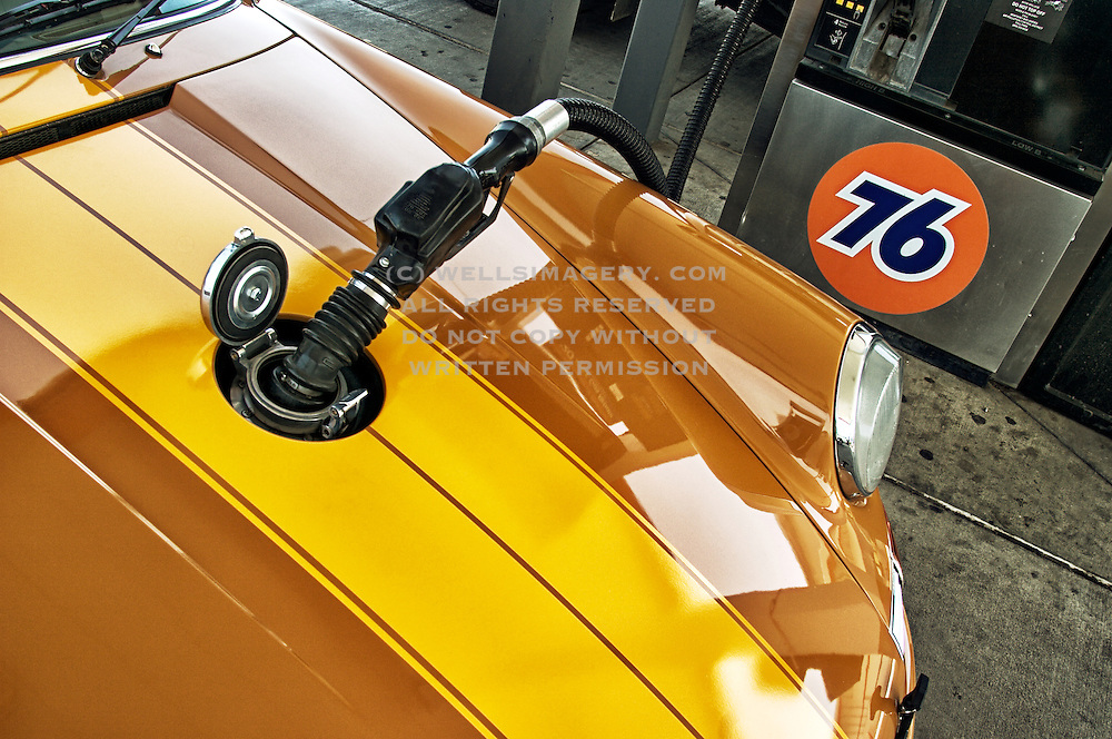 Image of Rob Dickinson fueling his 1969 Porsche 911E at R Gruppe Treffen in California, America west coast