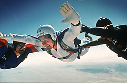 March 25, 1997 - Washington, DC, USA - Former US President George Bush skydiving to celebrate his 72nd birthday March 25, 1997 1997 at the Yuma Proving Ground Arizona. This is the first parachute jump made by the former president since he was shot down in his Navy plane in World War II. (Credit Image: © White House Photo/ZUMAPRESS.com)