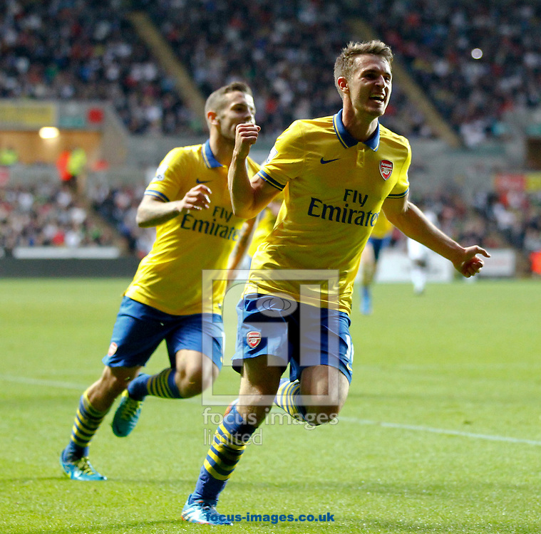 Picture by Mike  Griffiths/Focus Images Ltd +44 7766 223933<br /> 28/09/2013<br /> Aaron Ramsey of Arsenal celebrates his goal during the Barclays Premier League match at the Liberty Stadium, Swansea.