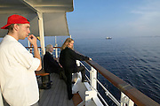 "The crew of ""Lili Marleen"" (luxurious sailing ship of Deilmann Cruises) having a break and watching other ships while approaching Copenhagen."