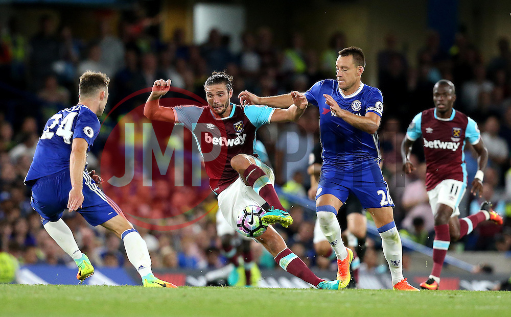 Andy Carroll of West Ham United runs with the ball against Gary Cahill and John Terry of Chelsea - Mandatory by-line: Robbie Stephenson/JMP - 15/08/2016 - FOOTBALL - Stamford Bridge - London, England - Chelsea v West Ham United - Premier League