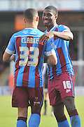 Hakeeb Adelakun of Scunthorpe United celebrtates scoring goal for Scunthorpe with Jordan Clarke of Scunthorpe United during the Sky Bet League 1 match between Scunthorpe United and Swindon Town at Glanford Park, Scunthorpe, England on 28 March 2016. Photo by Ian Lyall.