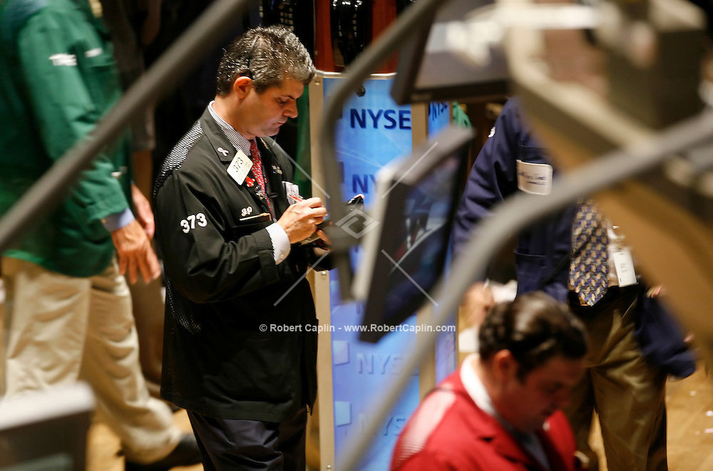 Traders on the floor of the New York Stock Exchange Fri. Sept. 22, 2006 Robert Caplin/Bloomberg News