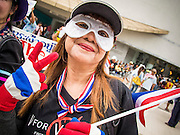 "14 JULY 2013 - BANGKOK, THAILAND:  An anti-government protester in Bangkok Sunday. About 150 members of the so called ""White Mask"" movement marched through the central shopping district of Bangkok Sunday to call for the resignation of Yingluck Shinawatra, the Prime Minister of Thailand. The White Mask protesters are strong supporters of the Thai monarchy. They claim that Yingluck is acting as a puppet for her brother, former Prime Minister Thaksin Shinawatra, who was deposed by a military coup in 2006 and now lives in exile in Dubai.       PHOTO BY JACK KURTZ"