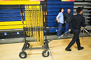 Students clean up the gymnasium after the Milpitas Unified School District's Tenth Annual Music Festival at Milpitas High School in Milpitas, California, on April 4, 2013. (Stan Olszewski/SOSKIphoto)