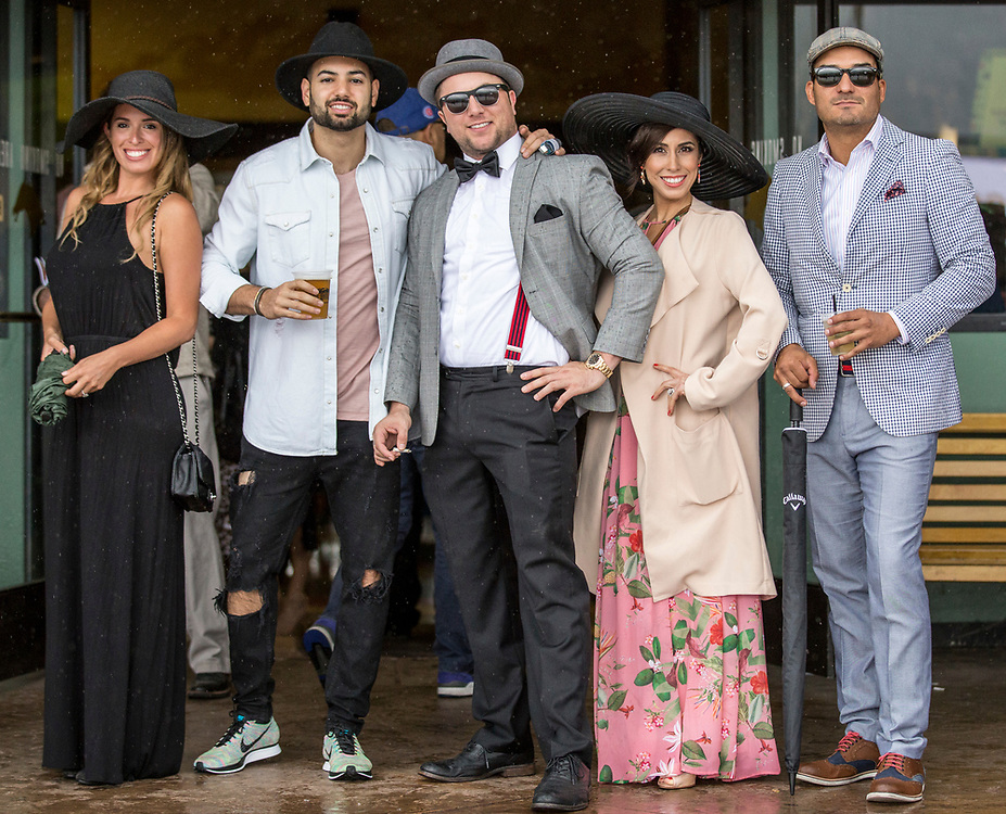 A group of people wearing elegant outfits poses for a portrait at Santa Anita Park the day of the Kentucky Derby, celebrated Saturday May 6, 2017. <br /> <br /> photo by Samuel Navarro / Sports Shooter Academy