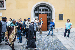 May 19, 2017 - Munich, Bavaria, Germany - Despite cancelling a registered Friday prayer session at Munich's Marienplatz, Muslims assembled and then walked to the St. Michael Church nearby for their Friday prayers.  The original demonstration was cancelled due to ''security concerns'' after radical-right figures began making posts on social networking regarding a counter-action.  At least three members of the III. Weg militant neo-nazi terror group, as well as Golden Dawn were in attendance, with at least two members of Pegida.  The original purpose of the demonstration was organized by Massi Popal to bring light to the inner city no longer having prayer spaces for muslims.  Furthermore, a reporter from Sueddeutsche Zeitung created a disturbance within the church after demanding to be allowed to photograph in the hall and being denied by the church management and the Staatsschutz (police).  He was then escorted out while yelling by the Staatsschutz.  Police speakers report that he threatened police with a criminal complaint, despite the fact that the Church operator asked for him to leave. (Credit Image: © Sachelle Babbar via ZUMA Wire)