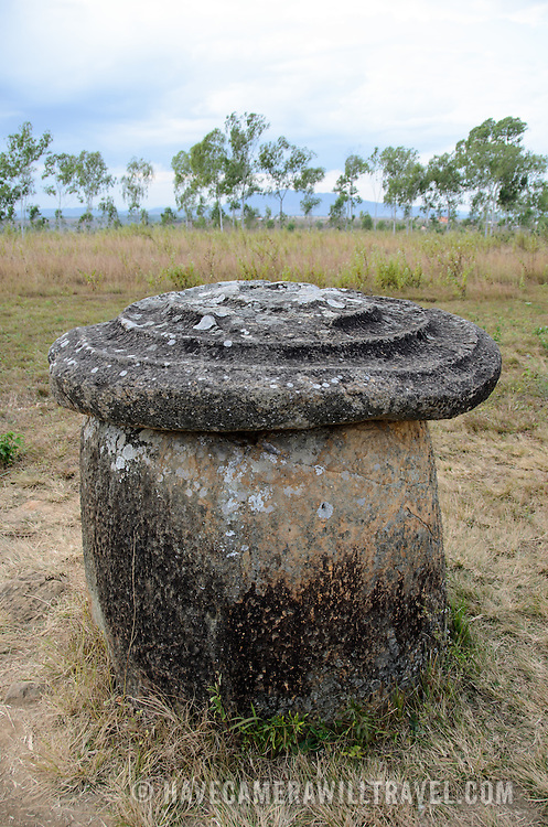A stone jar with a lid at Site 1 of the Plain of Jars in north-central Laos. Much remains unknown about the age and purpose of the thousands of stone jars clustered in the region. Most accounts date them to at least a couple of thousand years ago and theories have been put forward that they were used in burial rituals.