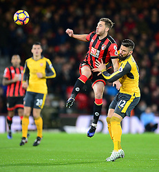 Dan Gosling of Bournemouth wins a high ball under pressure from Olivier Giroud of Arsenal - Mandatory by-line: Alex James/JMP - 03/01/2017 - FOOTBALL - Vitality Stadium - Bournemouth, England - Bournemouth v Arsenal - Premier League