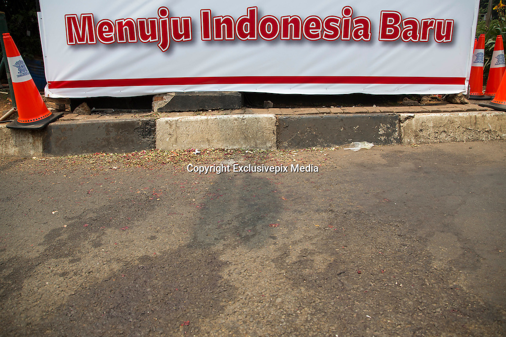 "Jakarta, Indonesia 17 January 2016 : <br /> <br /> The bombed Police Post covered with banner that say "" New Indonesia that love peace and not affraid to terror"". Jakarta back to normal again after the fatal attack at Starbuck Coffee at Thamrin Street. Peoples still visiting to the bombing site to take photos and condemn to the terrorist action.<br /> ©Exclusivepix Media"