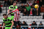 Forest Green Rovers Gavin Gunning(16) heads the ball clear during the EFL Sky Bet League 2 match between Lincoln City and Forest Green Rovers at Sincil Bank, Lincoln, United Kingdom on 3 November 2018.