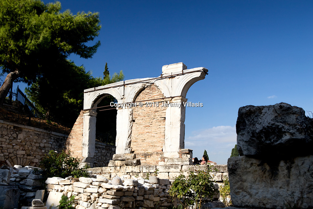 Part of the facade of the Agoranomeion, established in the middle of the 1st century AD. Built in the first century BC, the Roman Agora served as the new commercial center of Athens when it became part of the Roman Empire.