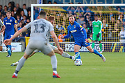 AFC Wimbledon midfielder Scott Wagstaff (7) trying a through ball during the EFL Sky Bet League 1 match between AFC Wimbledon and Portsmouth at the Cherry Red Records Stadium, Kingston, England on 19 October 2019.