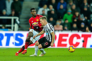 Paul Pogba (#6) of Manchester United takes on Matt Ritchie (#11) of Newcastle United during the Premier League match between Newcastle United and Manchester United at St. James's Park, Newcastle, England on 2 January 2019.