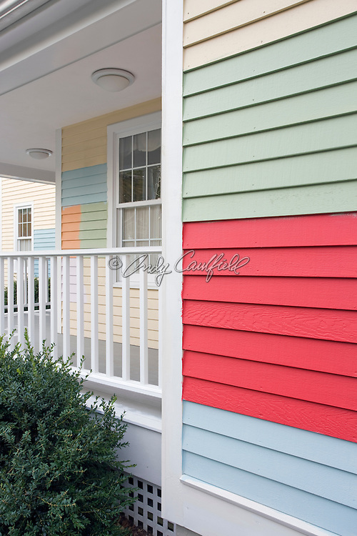 Clapboard sided home painted in several sample colors to help homeowner make decision