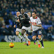 Mark Davies (Bolton) runs past Toumani Diagouraga (Brentford) in midfield during the Sky Bet Championship match between Bolton Wanderers and Brentford at the Macron Stadium, Bolton, England on 30 November 2015. Photo by Mark P Doherty.