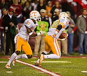 Nov 12, 2011; Fayetteville, AR, USA;  Tennessee Volunteers wide receiver Chris Cates (40) carries the ball as defensive back Prentiss Waggner (23) follows behind during a game against the Arkansas Razorbacks at Donald W. Reynolds Razorback Stadium. Arkansas defeated Tennessee 49-7. Mandatory Credit: Beth Hall-US PRESSWIRE