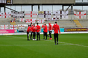 Milton Keynes Dons players chatting on the pitch prior to the The FA Cup match between Northampton Town and Milton Keynes Dons at Sixfields Stadium, Northampton, England on 9 January 2016. Photo by Dennis Goodwin.