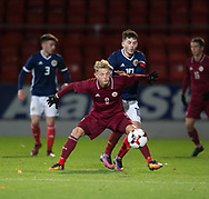 10th November 2017, McDiarmid Park, Perth, Scotland, UEFA Under-21 European Championships Qualifier, Scotland versus Latvia; Latvia's Andrejs Ciganiks holds off Scotland's Lewis Morgan