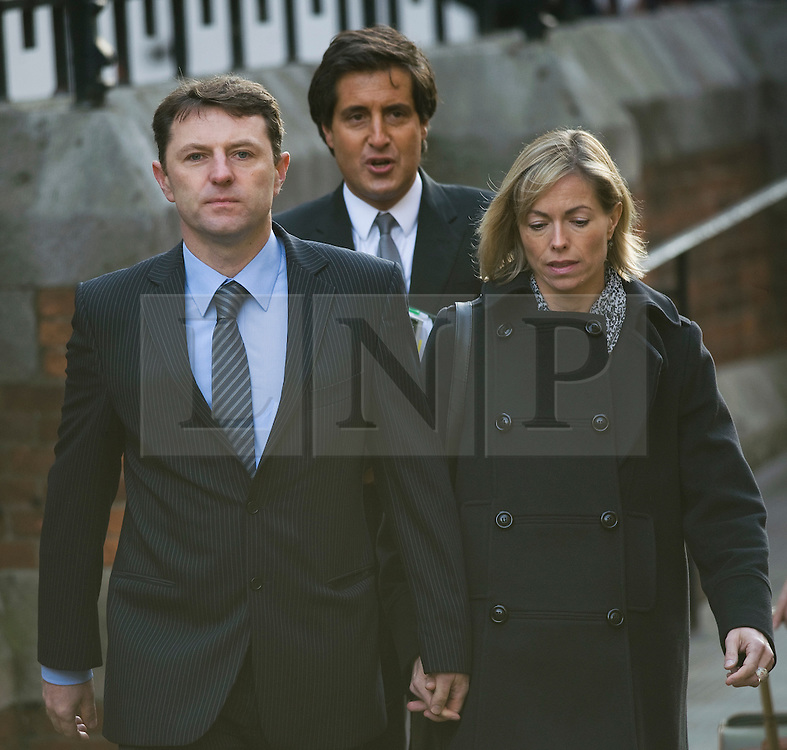 © London News Pictures. 23/11/2011. London, UK.  Gerry and Kate McCann arriving at The Royal Courts of Justice today (23/11/2011) where Gerry McCann is dueto give evidence at the Leveson Inquiry into press standards. The inquiry is being lead by Lord Justice Leveson and is looking into the culture, and practice of the UK press. Photo credit : Ben Cawthra/LNP