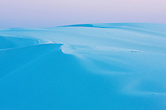 Early morning light falls on the white gypsum sand of White Sands National Monument, New Mexico