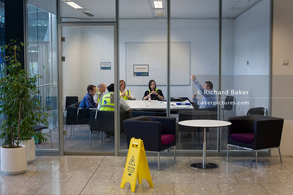 An employee raises his hand during airport operator BAA's company meeting at Heathrow's Terminal 5.