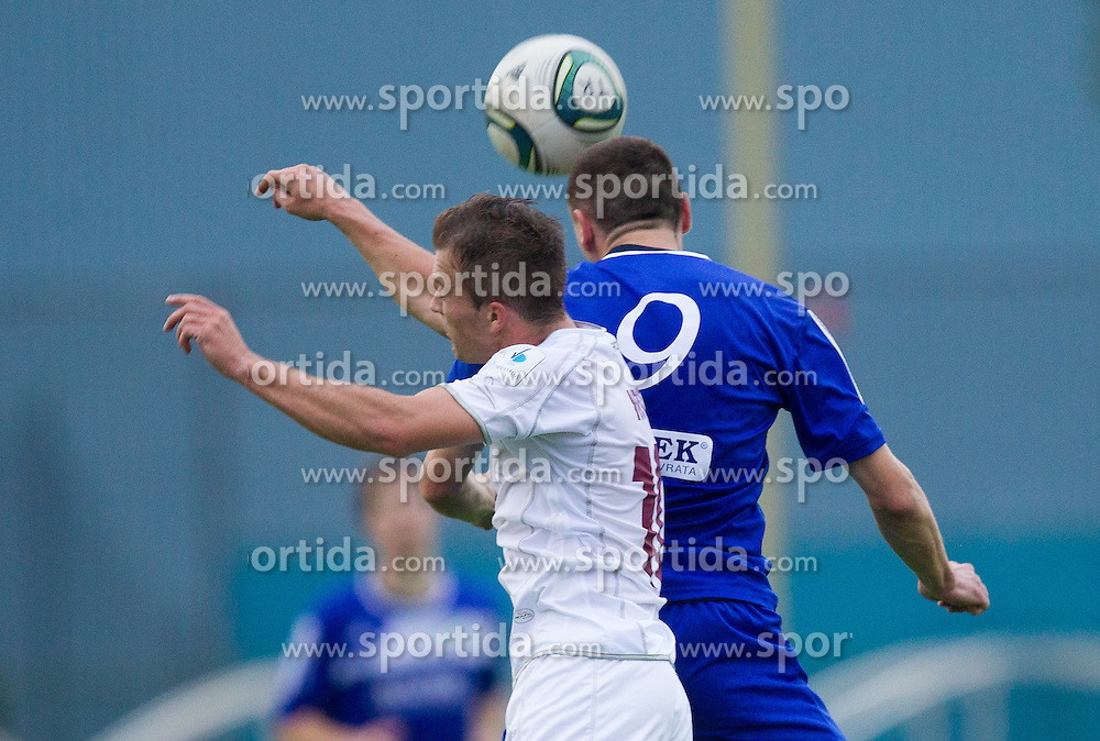 Alen Krcic of Triglav vs Goran Vuk of Dob during football match between NK Triglav and Roltek Dob of 1st Leg Qualifications of PrvaLiga 2012/13, on June 2, 2012 in Sports centre, Kranj, Slovenia. Roltek Dob defeated Triglav 2-0. (Photo by Vid Ponikvar / Sportida.com)