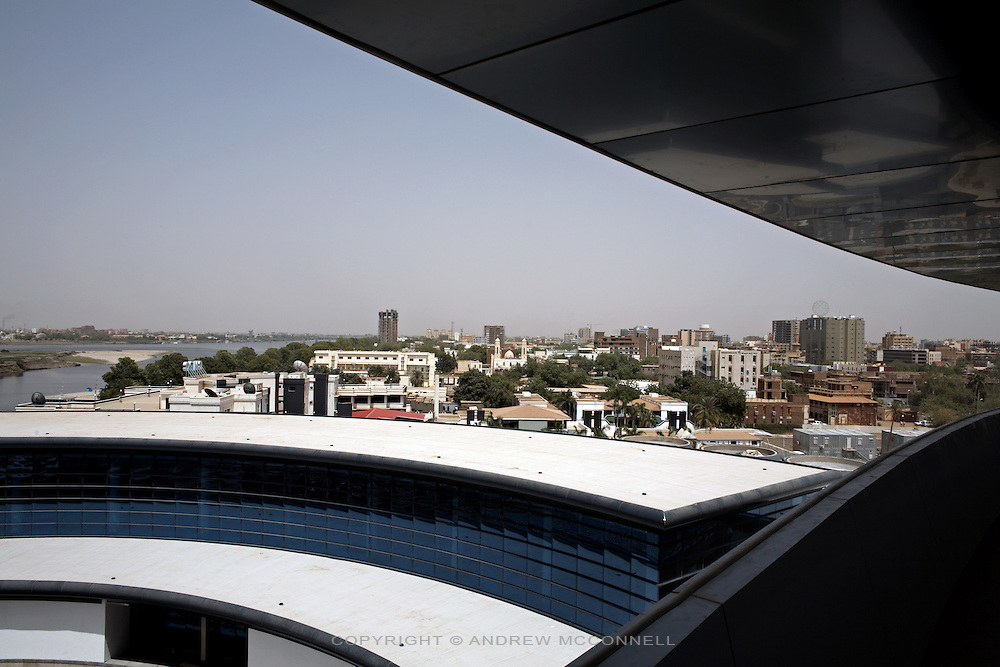 The view from the new Borj Al-Fateh Hotel in central Khartoum, Sudan, on Tuesday, Apr. 10, 2007. The Hotel, designed to represent a sail,  opened in November 2007 and is one of a number of 5-star hotels planned for the city..Khartoum is modeling itself as the Dubai of Africa and despite Western sanctions the city is booming. Away from the troubles and poverty that plaque the rest of Sudan, development in Khartoum is moving at an astonishing rate. Investment from the East, and in particular China, allowed the Sudanese economy to grow by 11% in 2007. This growth is driven largely by oil, with production rising from 63,000 barrels per day in 1999 to over 500,000 barrels today.
