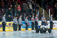 KELOWNA, CANADA -JANUARY 29: Minor hockey referees join WHL officials on the ice as the Kelowna Rockets host the Spokane Chiefs on January 29, 2014 at Prospera Place in Kelowna, British Columbia, Canada.   (Photo by Marissa Baecker/Getty Images)  *** Local Caption *** referees; officials;