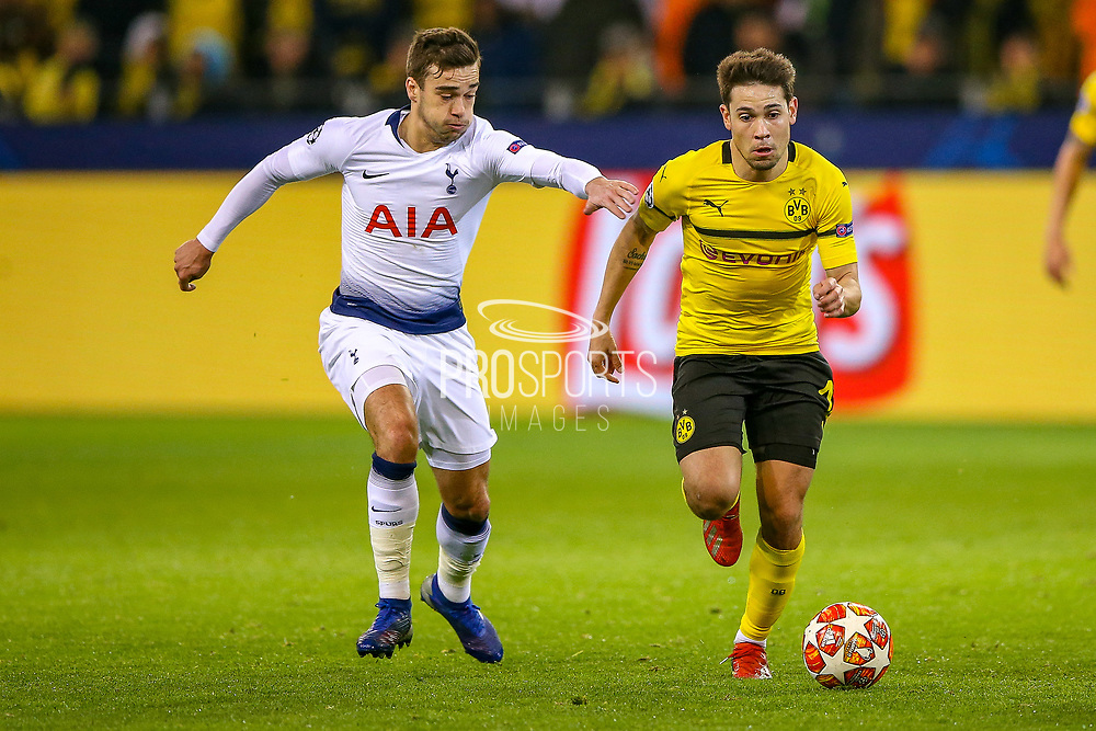 Tottenham Hotspur midfielder Harry Winks (8) tries to pull back Borussia Dortmund defender Raphaël Guerreiro (13)  during the Champions League round of 16, leg 2 of 2 match between Borussia Dortmund and Tottenham Hotspur at Signal Iduna Park, Dortmund, Germany on 5 March 2019.