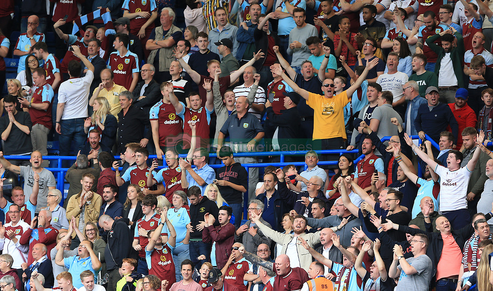Burnley supporters celebrate after the final whistle