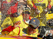 NASCAR Sprint Cup Series driver Joey Logano, bottom is doused with beer as he and his crew celebrate their victory in the Hollywood Casino 400 at Kansas Speedway in Kansas City, Kan., Sunday, Oct. 5, 2014. (AP Photo/Colin E. Braley)
