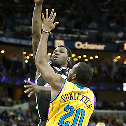 January 22, 2011; New Orleans, LA, USA; San Antonio Spurs forward DeJuan Blair (45) shoots over New Orleans Hornets small forward Quincy Pondexter (20) during the fourth quarter at the New Orleans Arena. The Hornets defeated the Spurs 96-72.  Mandatory Credit: Derick E. Hingle
