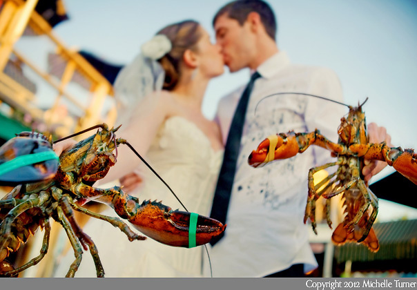 The bride and groom with their lobsters at a wedding in Bar Harbor, Maine.  Image by Maine Wedding Photographer Michelle Turner.
