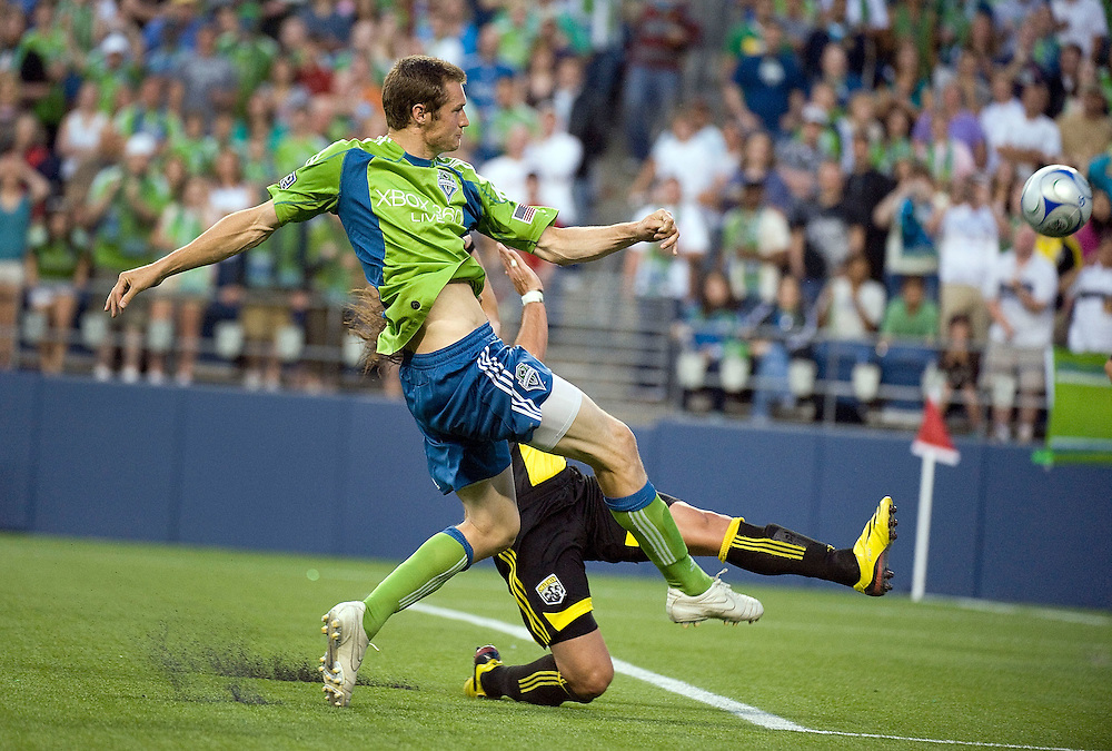 SEATTLE - MAY 30:  Seattle Sounders FC forward Nate Jaqua scores in the second half to even the match with Columbus at 1-1 at Qwest Field on May 30, 2009 in Seattle, Washington.  (Photo by Rod Mar/MLS via Getty Images)