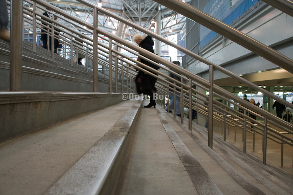 low angle view of a person walking up the stairs
