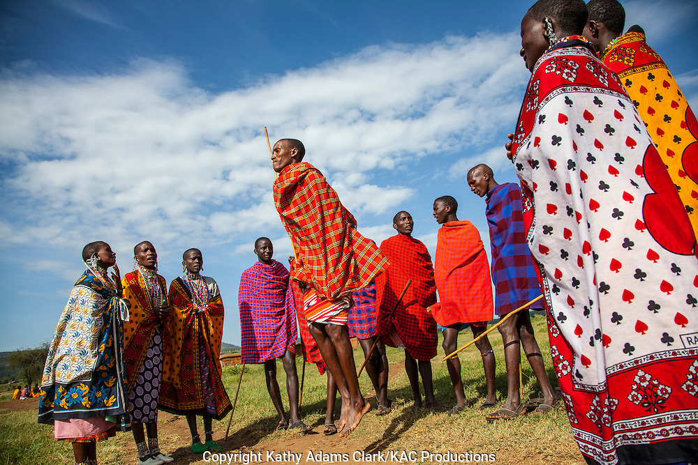 Maasai young people doing a jumping dance at a village outside, Serengeti National Park, Tanzania, Africa.