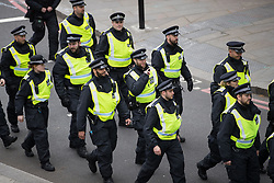 © Licensed to London News Pictures . 01/04/2017 . London , UK . Police on Northumberland Avenue . The EDL and Britain First both hold demonstrations in London , opposed by anti-fascist groups , including Unite Against Fascism . Photo credit : Joel Goodman/LNP