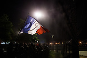 June 13-18, 2017. 24 hours of Le Mans. A fan waves a French flag at night.