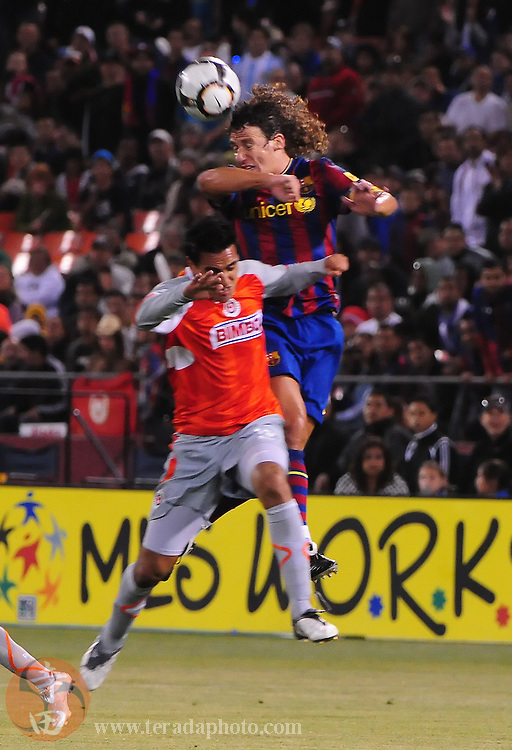 August 8, 2009; San Francisco, CA, USA; FC Barcelona defender Carles Puyol (top) heads the ball over Chivas de Guadalajara forward Jesus Padilla (bottom) during the second half in the Night of Champions international friendly contest at Candlestick Park. The game ended in a 1-1 tie.