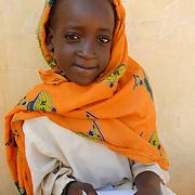 Sudan. Darfur. El Geneina . Kendrig camp for Internally Displaced People. Kubri school - 1st grade.<br /> Kubra Al Aziz Mohammed writes on the blackboard.