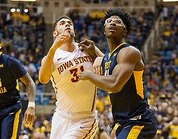 Feb 22, 2016; Morgantown, WV, USA; West Virginia Mountaineers forward Devin Williams (41) boxes out Iowa State Cyclones forward Georges Niang (31) during the first half at the WVU Coliseum. Mandatory Credit: Ben Queen-USA TODAY Sports
