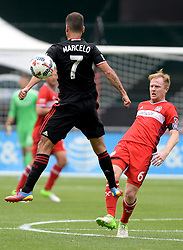 May 20, 2017 - Washington, DC, USA - 20170520 - Chicago Fire midfielder DAX MCCARTY (6) passes around D.C. United midfielder MARCELO SARVAS (7) in the first half at RFK Stadium in Washington. (Credit Image: © Chuck Myers via ZUMA Wire)