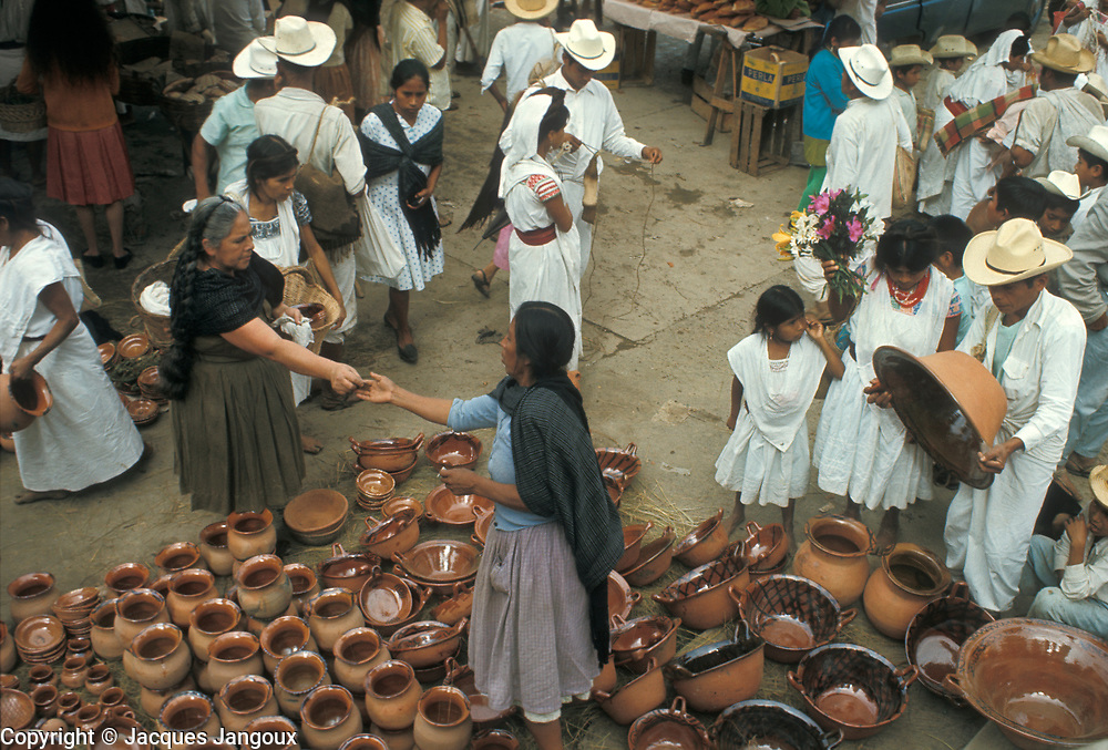 Mexico, Puebla State: Sunday market in small town: Cuetzalan: woman selling clay pots.
