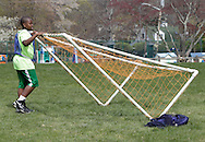 Middletown, New York - A boy fixes the goal during a soccer program at the Middletown YMCA on April 14, 2012.