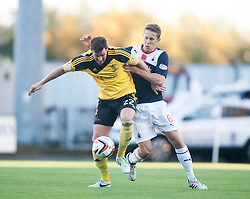 Livingston Andy Barrowman and Falkirk's Will Vaulks.<br />