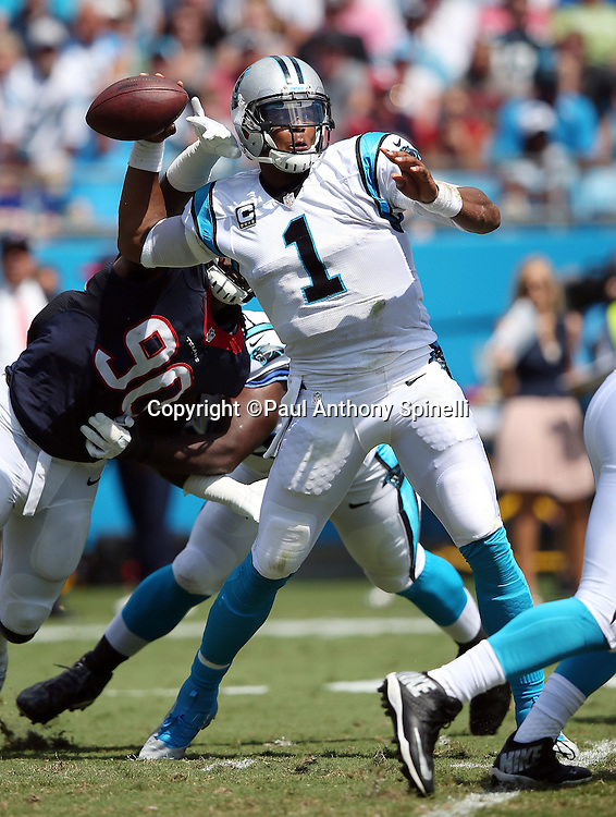 Carolina Panthers quarterback Cam Newton (1) throws a pass during the 2015 NFL week 2 regular season football game against the Houston Texans on Sunday, Sept. 20, 2015 in Charlotte, N.C. The Panthers won the game 24-17. (©Paul Anthony Spinelli)